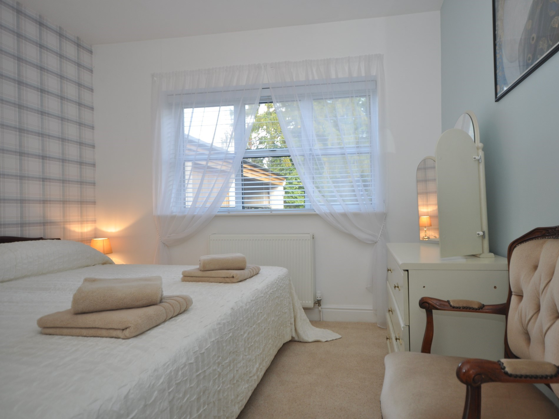 Wake up to the morning sun and bird song in this spacious king-size bedroom