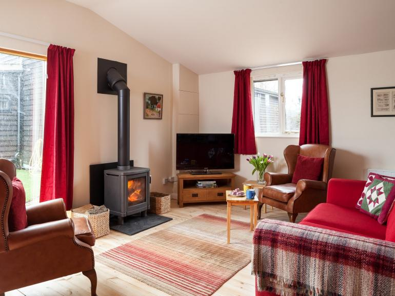 Lounge with cosy wood burner