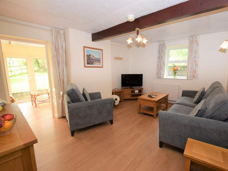 Welcoming lounge and through to conservatory