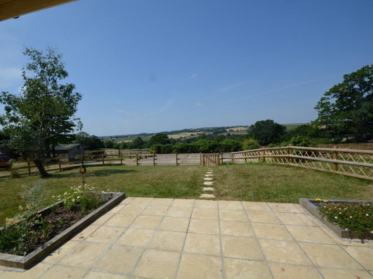 Enjoy the stunning views from your private patio and garden
