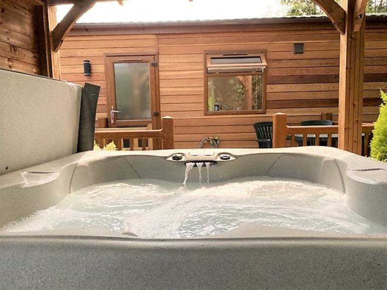 Hot tub with shelter above