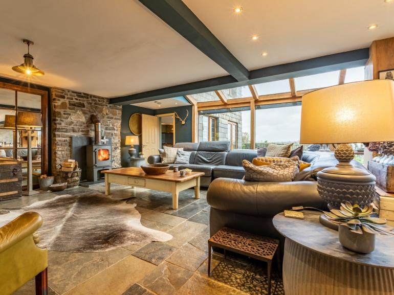 Stunning lounge with TV and woodburner