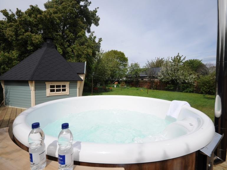 Relax in the eco-friendly wood fired hot tub
