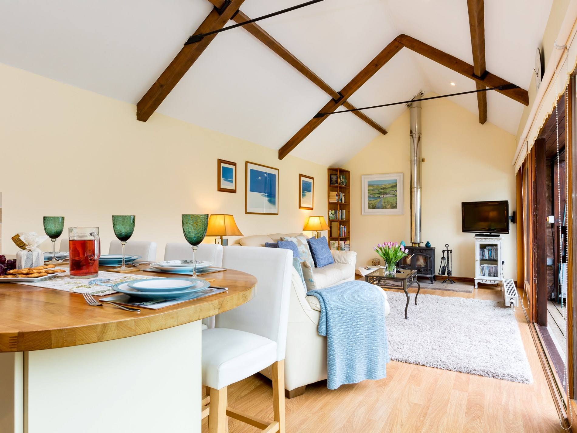 Light and spacious lounge/kitchen/dining room with woodburner