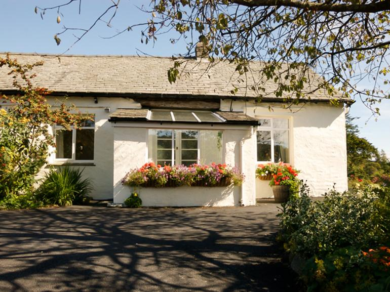 The property is set in an elevated position close to Tarn Hows