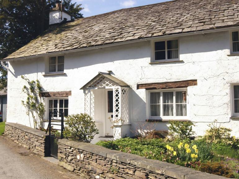 A traditional whitewashed lakeland cottage