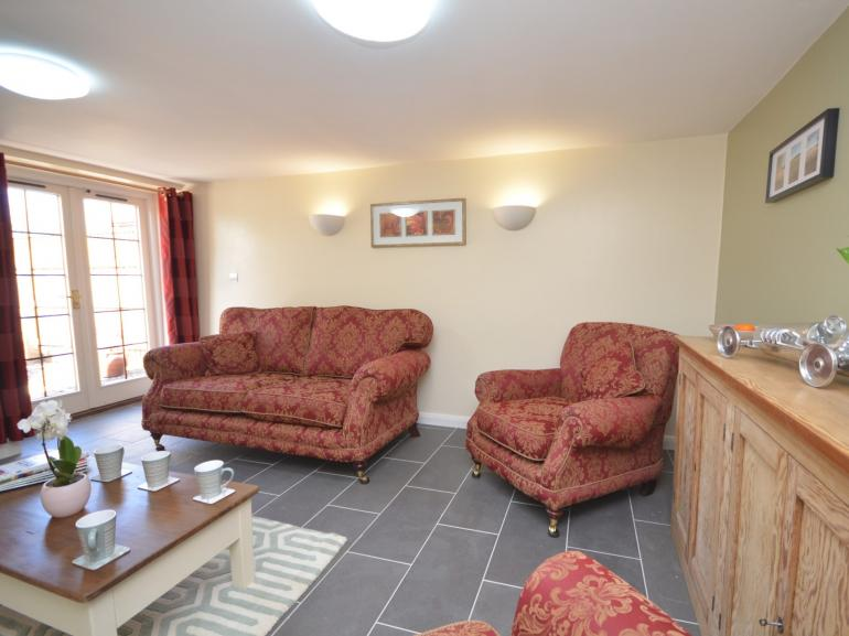 Relax in the lounge with French doors opening onto the enclosed patio