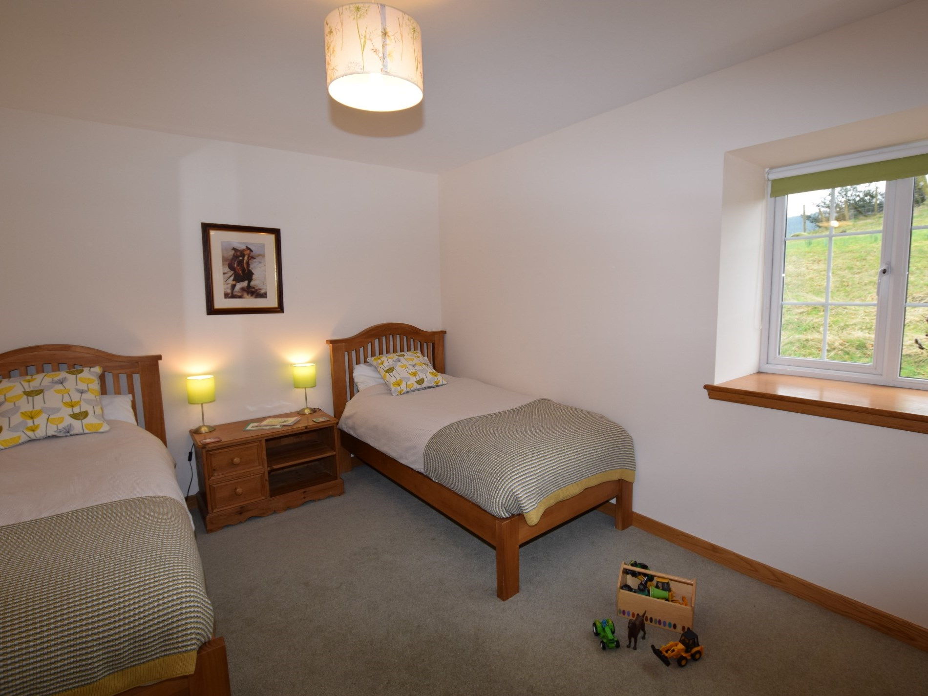 Twin bedroom with children's toys