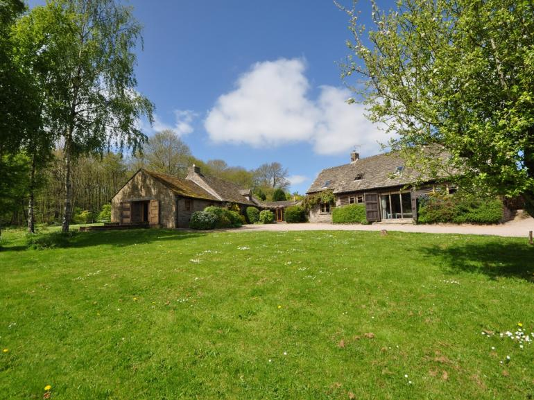 Set within acres of garden and woodland