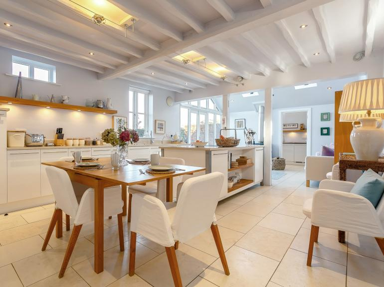 Open plan kitchen with dining area, looking through to the lounge