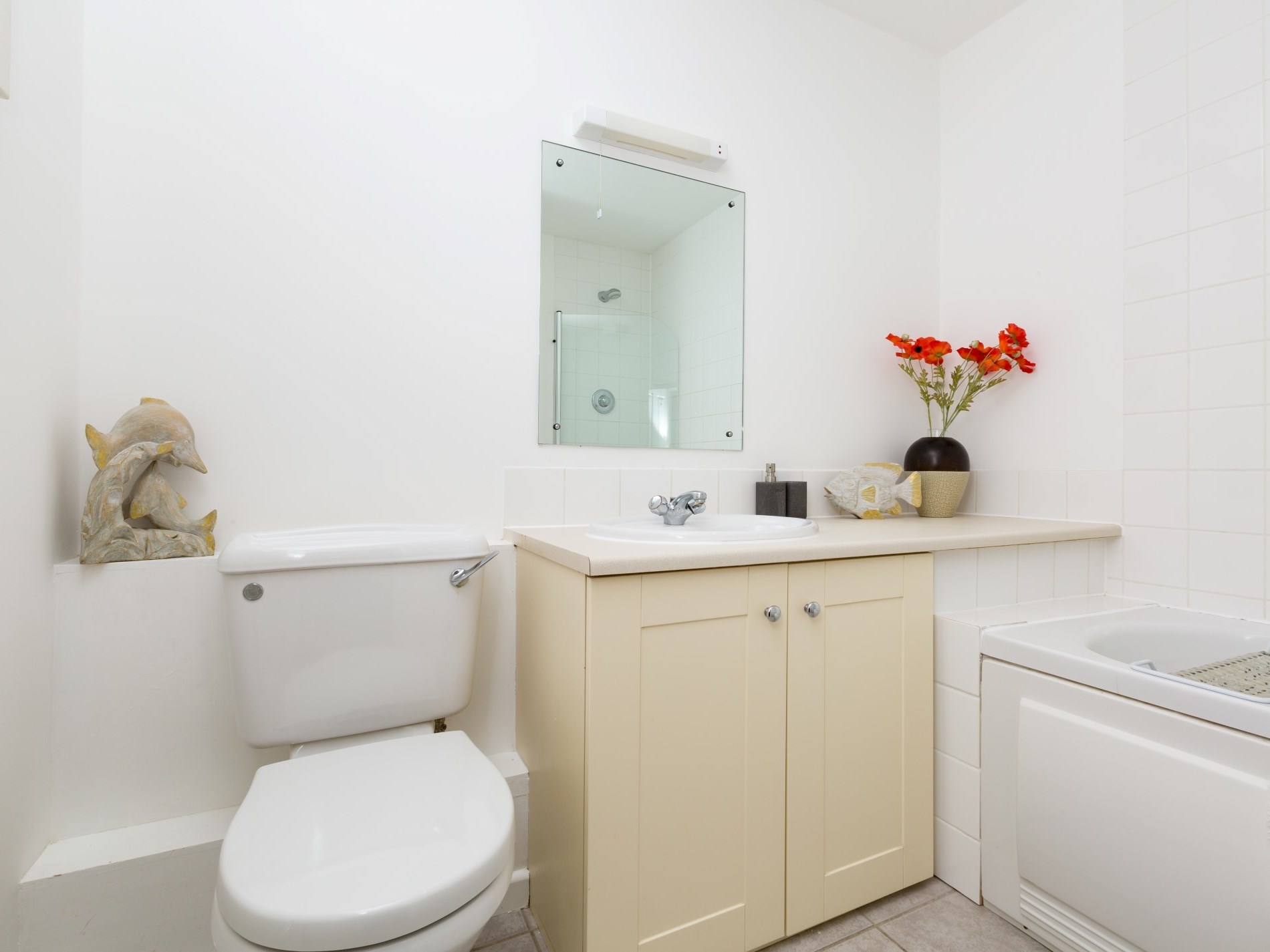 Family bathroom with shower over