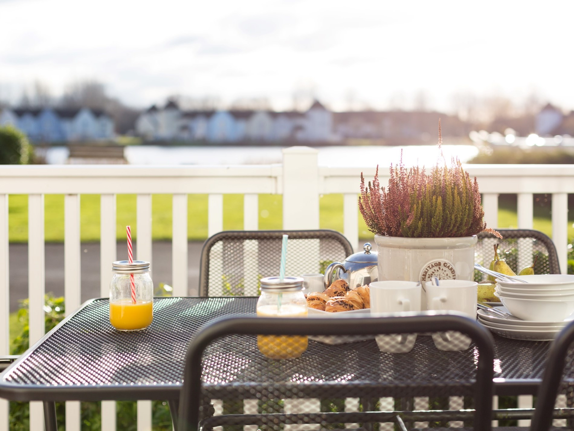 Lovely balcony with garden furniture and BBQ