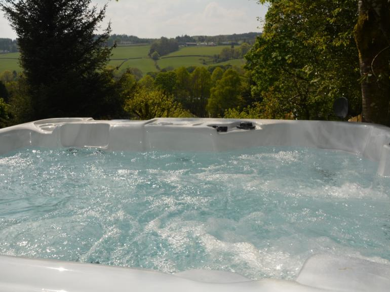 Relax and enjoy the private spacious hot tub with magnificent views