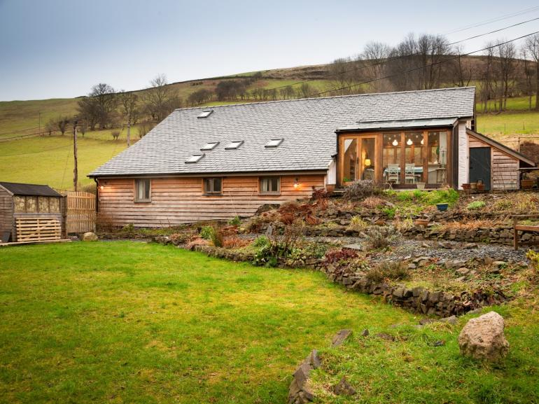 A converted barn set in a quiet valley
