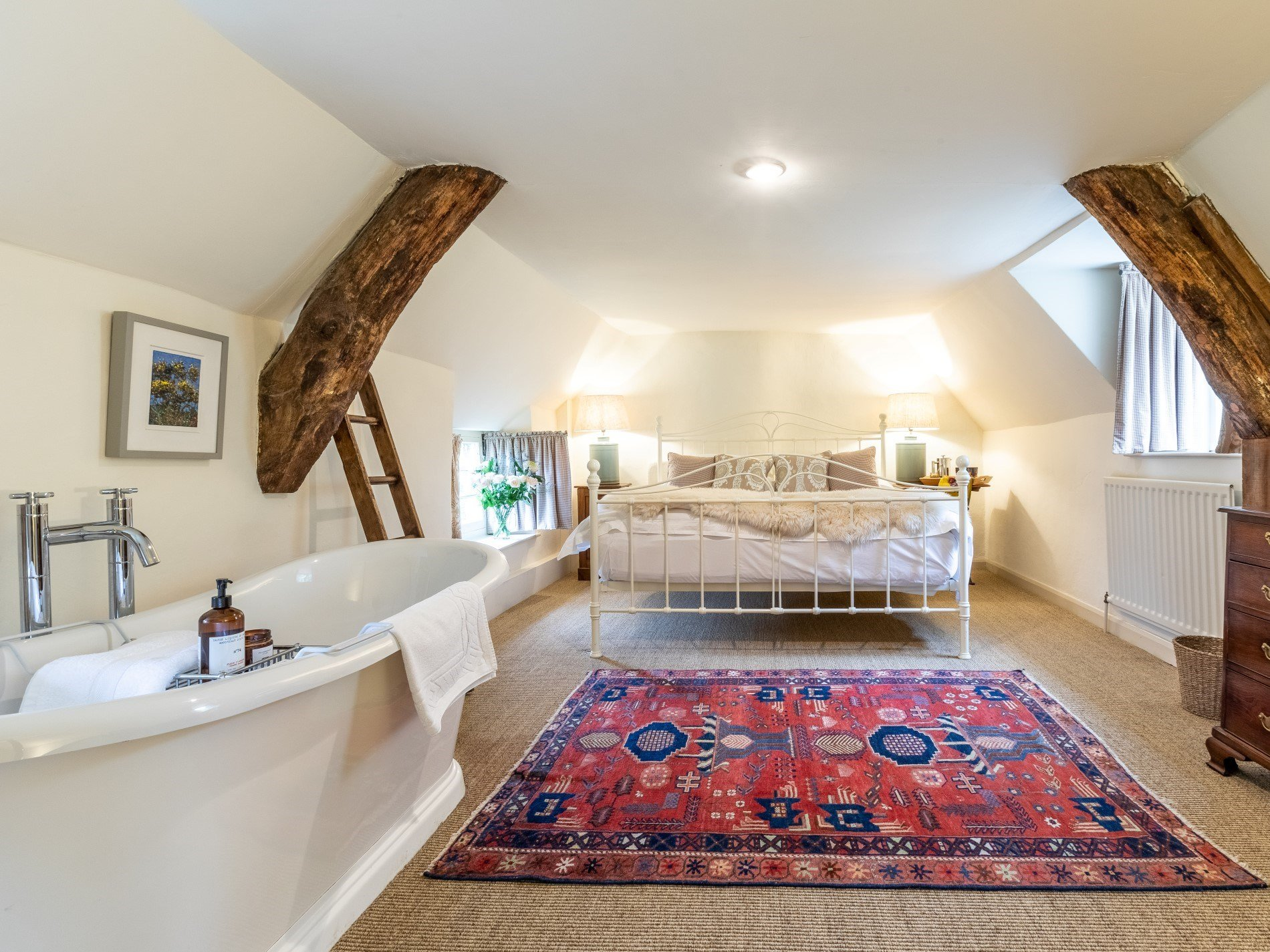 Super-king-size bedroom complete with slipper bath