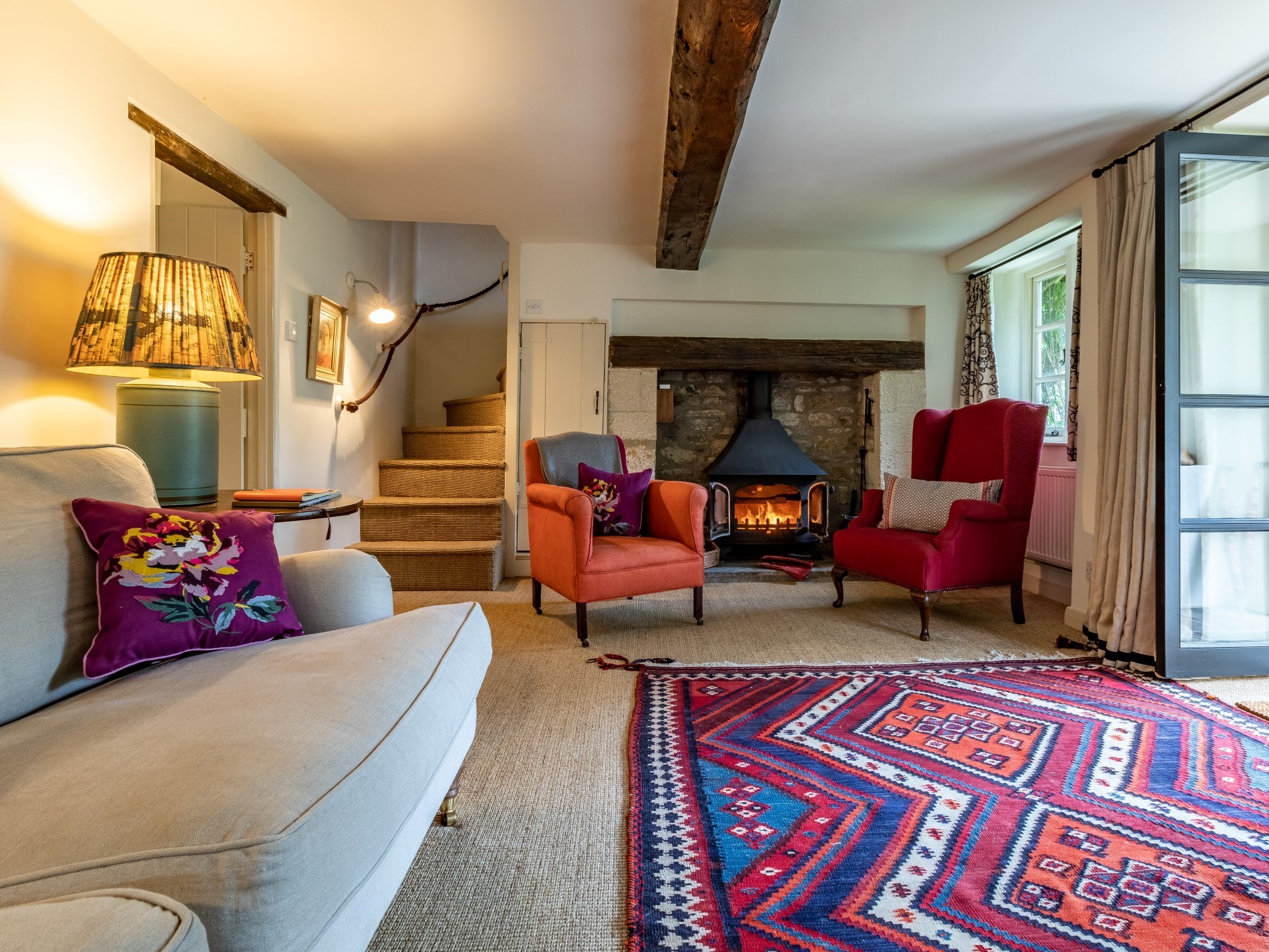 Large lounge with warming woodburner