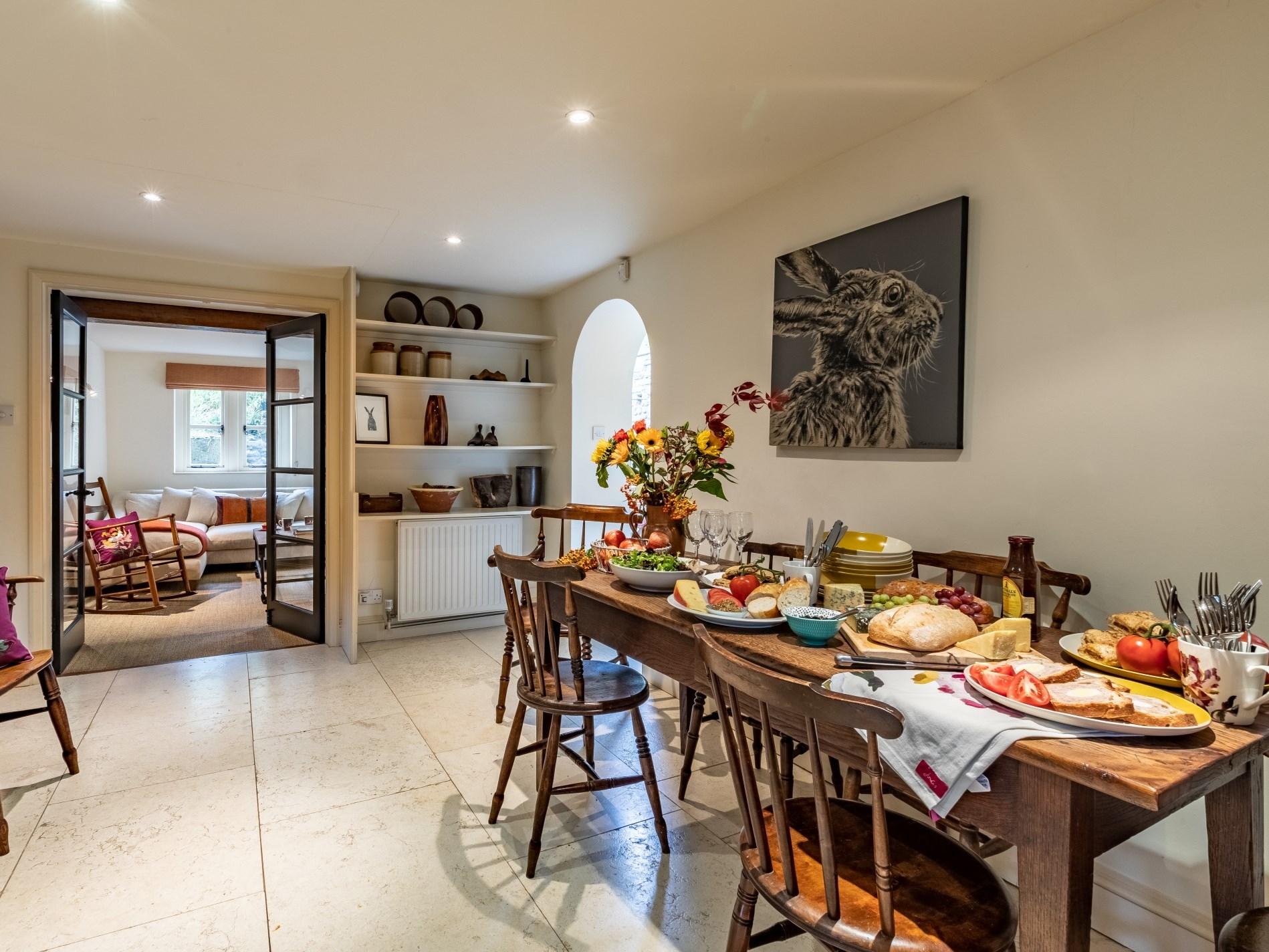 Boasting an antique table and chairs, the dining room is the perfect place to entertain