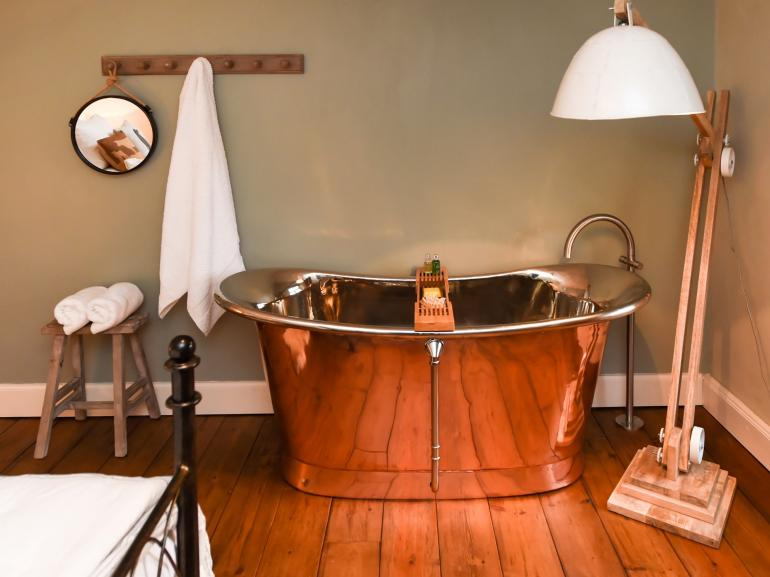 Copper bath in the king-size bedroom
