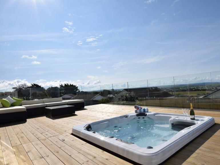 Enjoy the beautiful views from the sunken hot tub