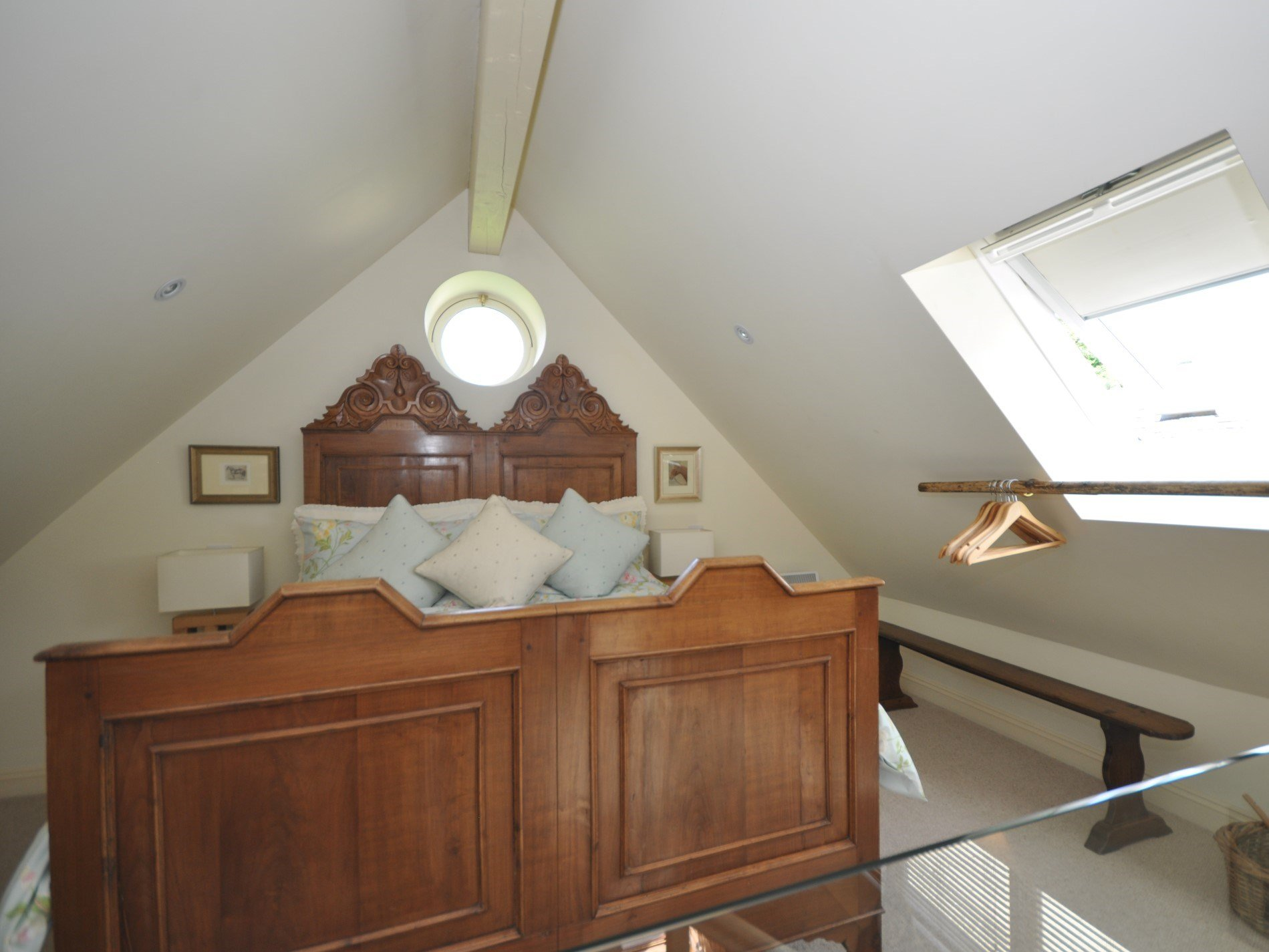 The mezzanine bedroom within the eaves