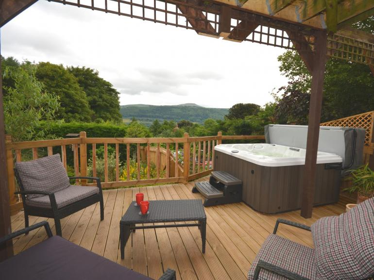 A beautiful spot to relax in with your own hot tub whilst looking out to Sugar Loaf mountain