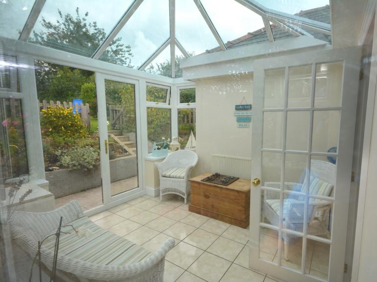 Delightful conservatory overlooking the garden - ideal for a relaxing afternoon