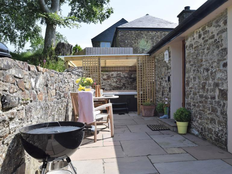 Private enclosed patio area with private hot tub and BBQ