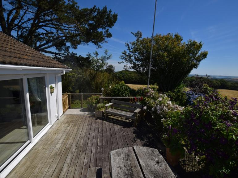 Beautiful sun trap decking with rolling counrtyside and sea views