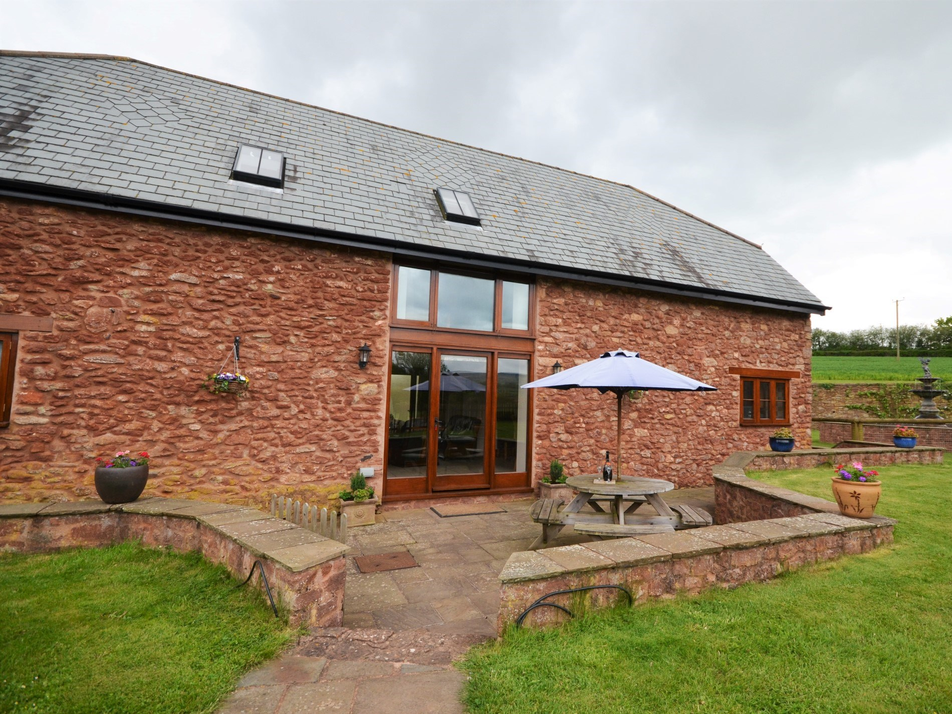 View towards this wonderful property with patio area