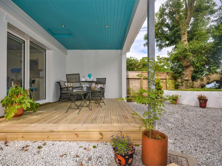 Beautifully appointed decked area with seating