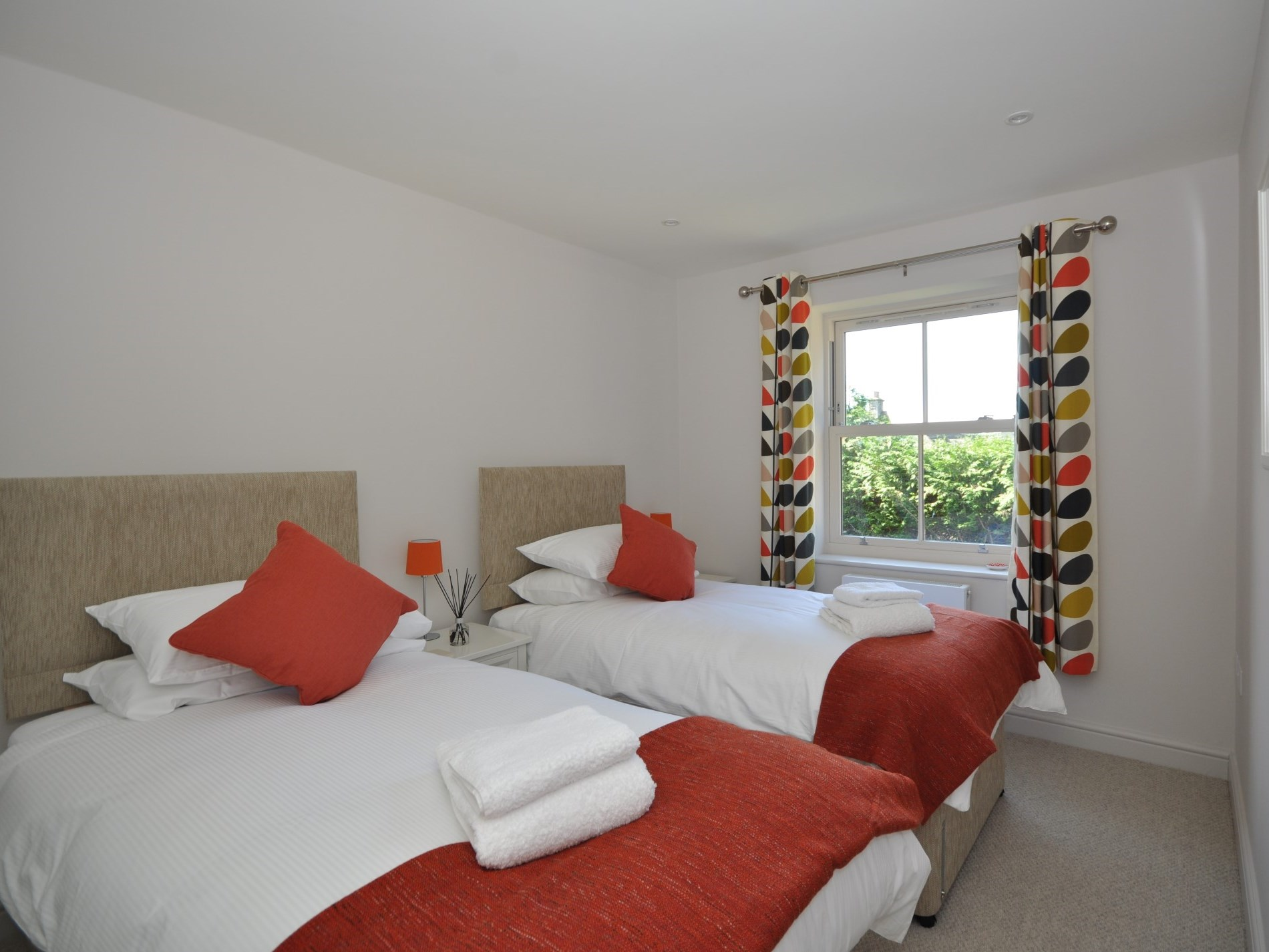 A spacious twin bedroom