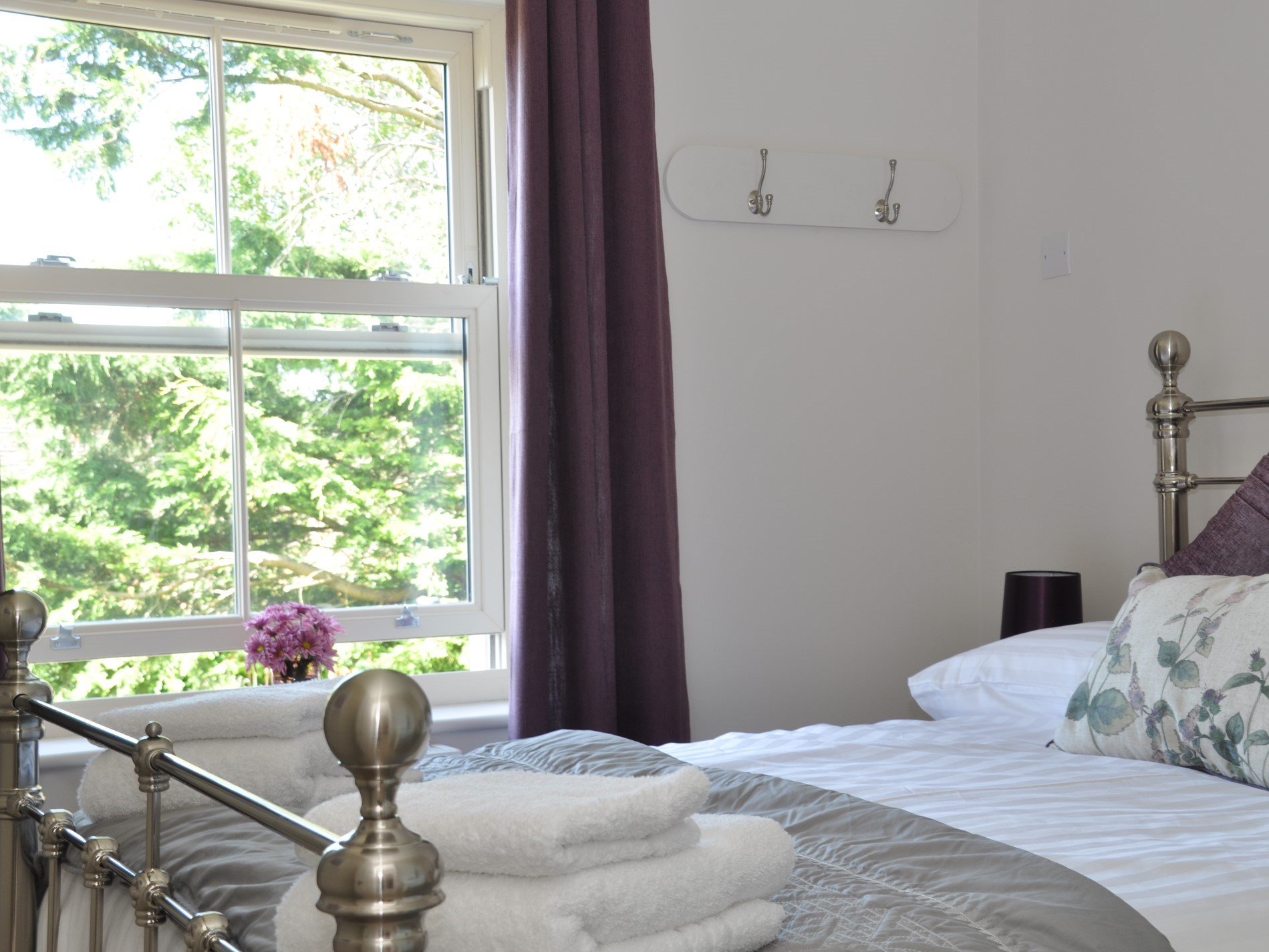 A first floor double room with a garden view