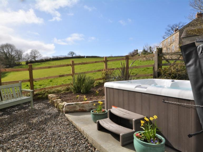 Sit back in your private hot tub and take in the countryside views