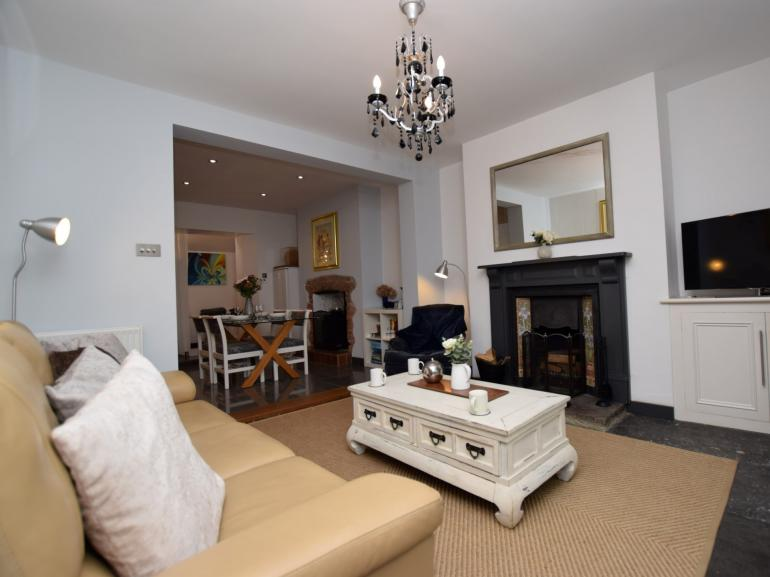 Relax and unwind by the fire in the open-plan living space