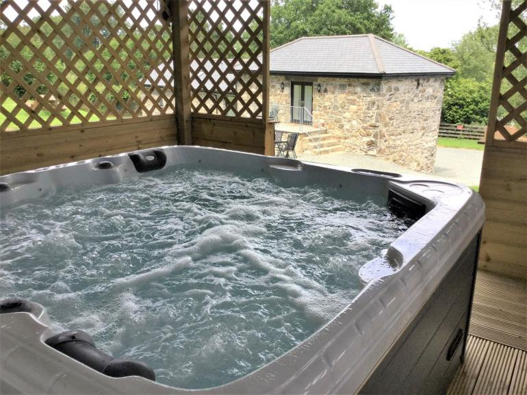 Relax in the undercover hot tub