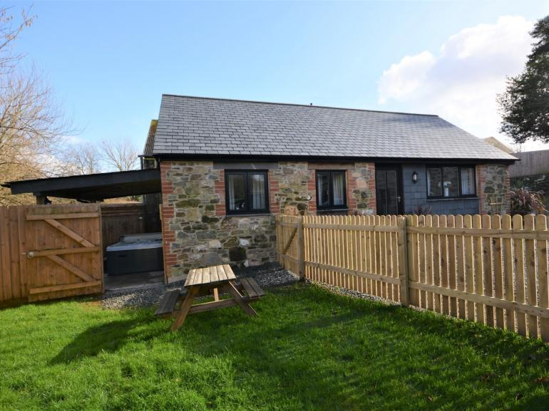 Barn conversion with parking, hot tub and enclosed garden