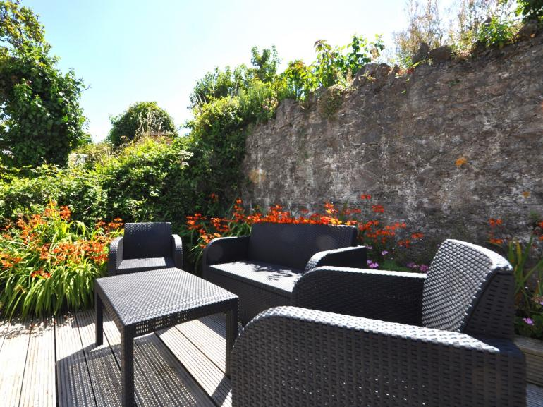 Relax and enjoy the sea views in the elevated rear garden