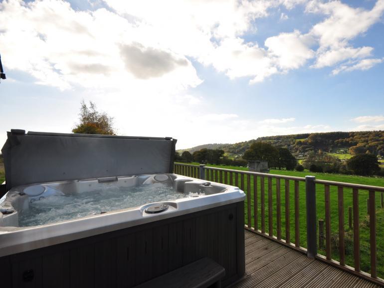 Enjoy a soak in the private hot tub