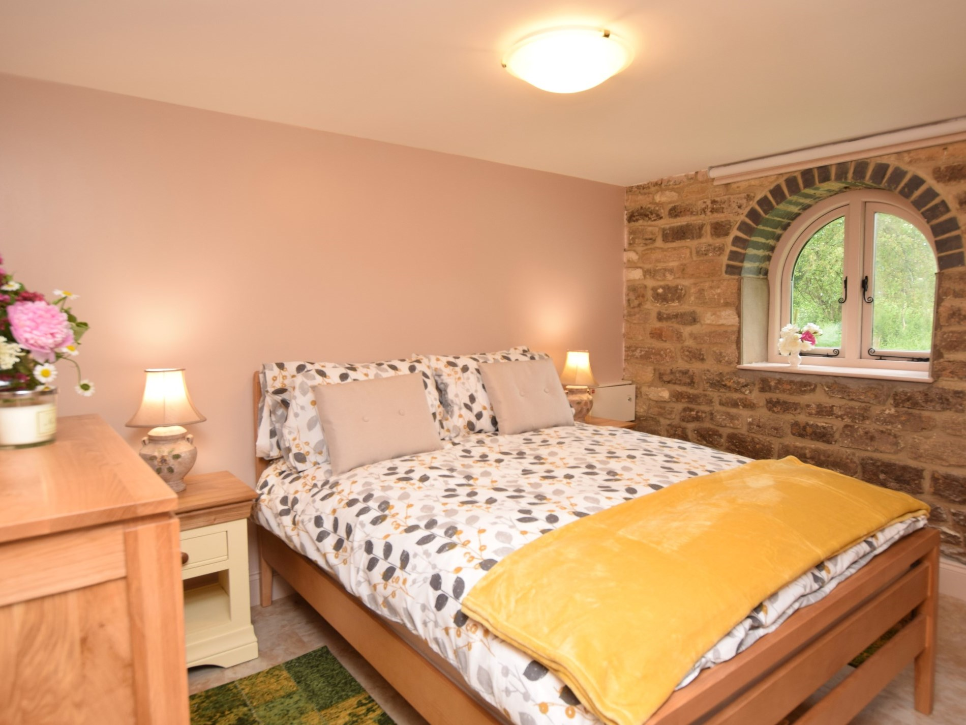 Tuck up in the beautiful bedroom with exposed stonework