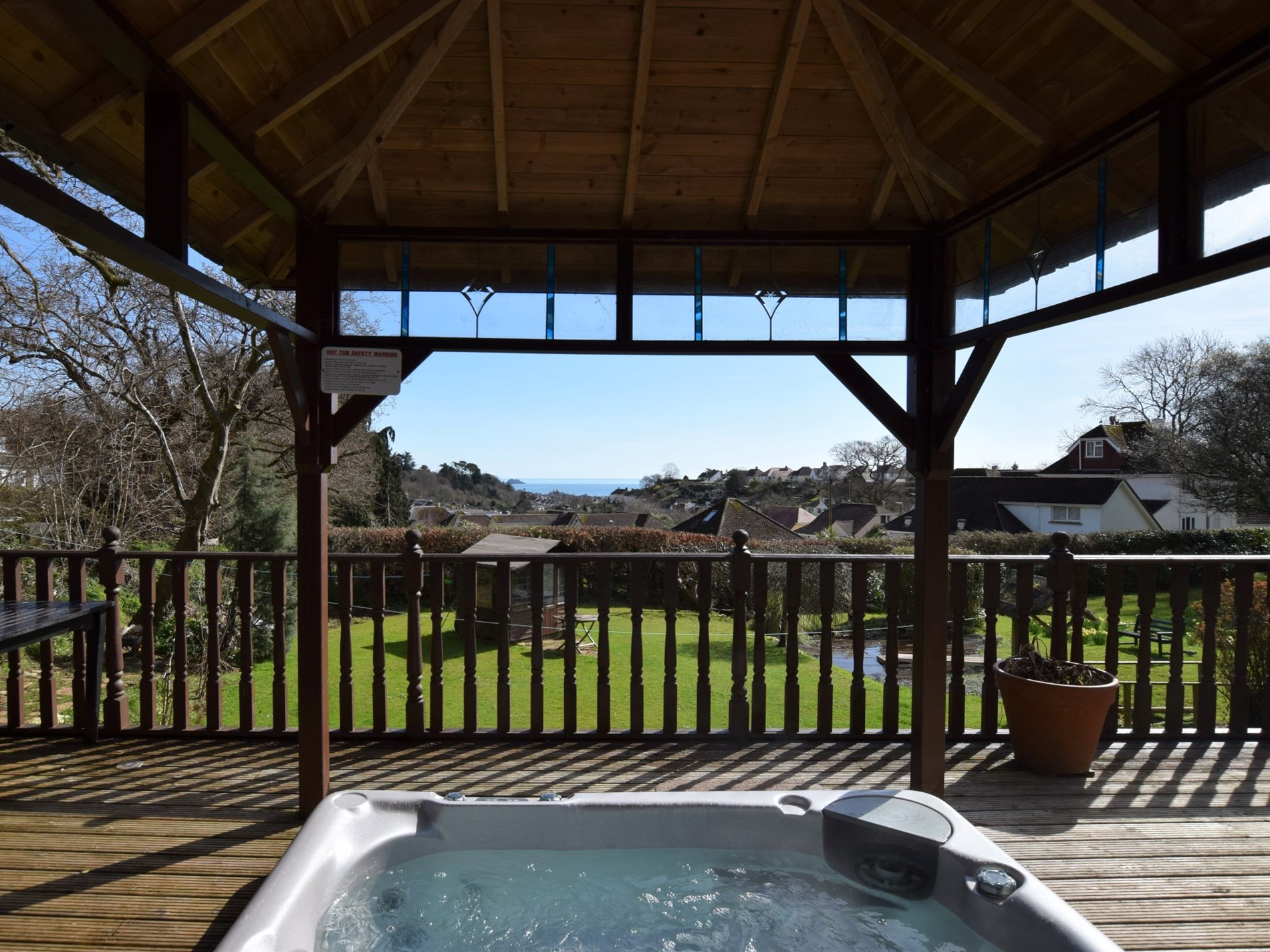 Enjoy the private hot tub with far reaching sea views over Torbay