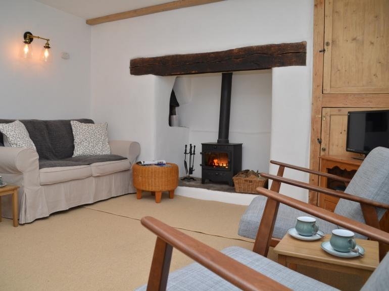 Relax in front of this cosy wood burner