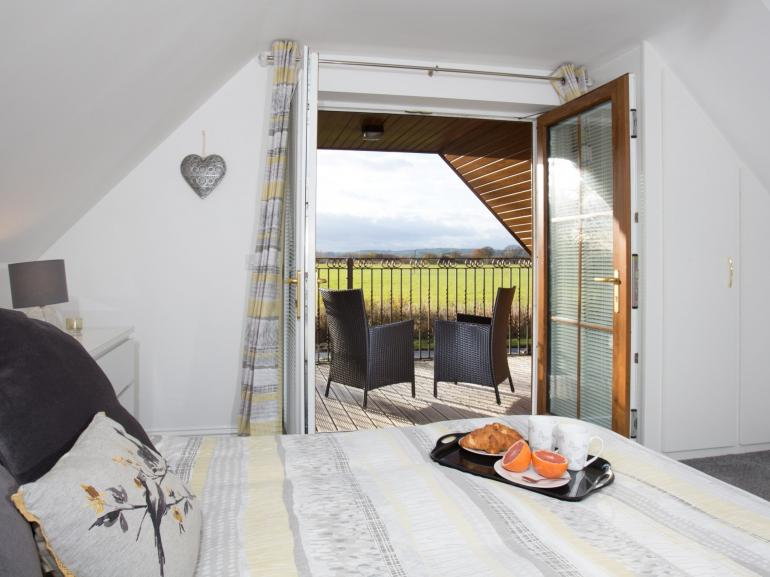 Double bedroom with a magnificent covered balcony to enjoy the views and unwind