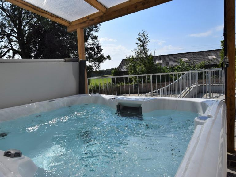 Hot tub area with countryside views