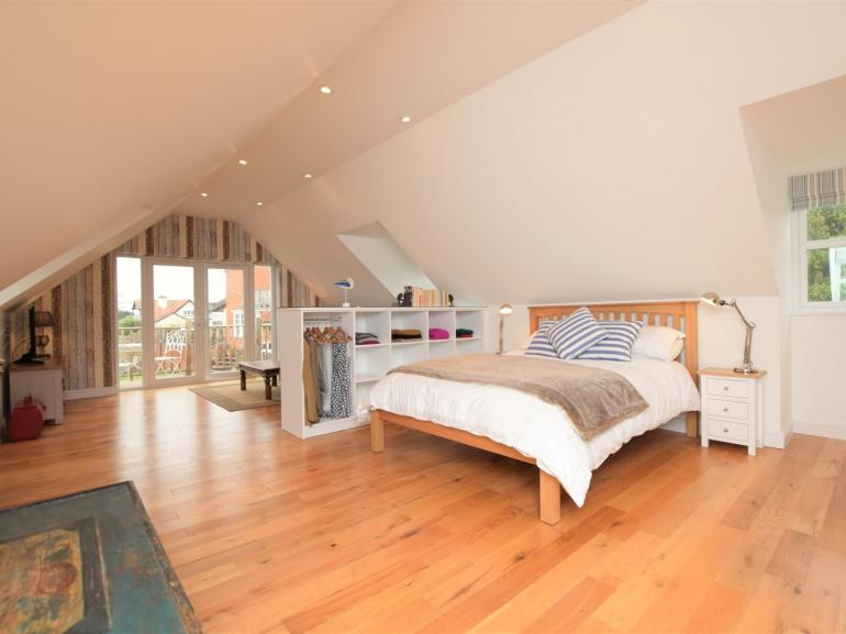 Open-plan living which leads onto the balcony which boast dazzling sea views