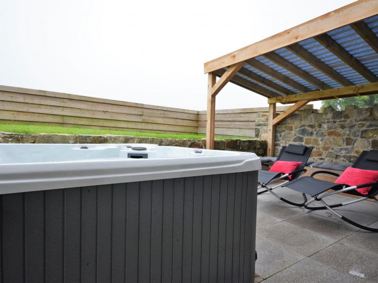 Private hot tub to enjoy during your stay