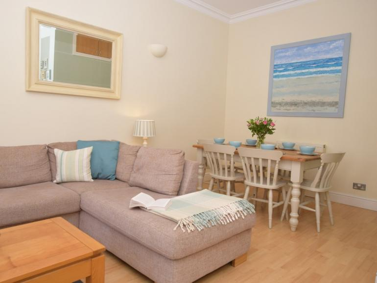 Spacious lounge/dining room in this seaside property