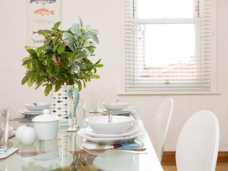 Enjoy a leisurely meal in this delightful seaside cottage