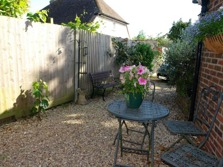 Relax with your favourite drink in the courtyard of this quiet hideaway