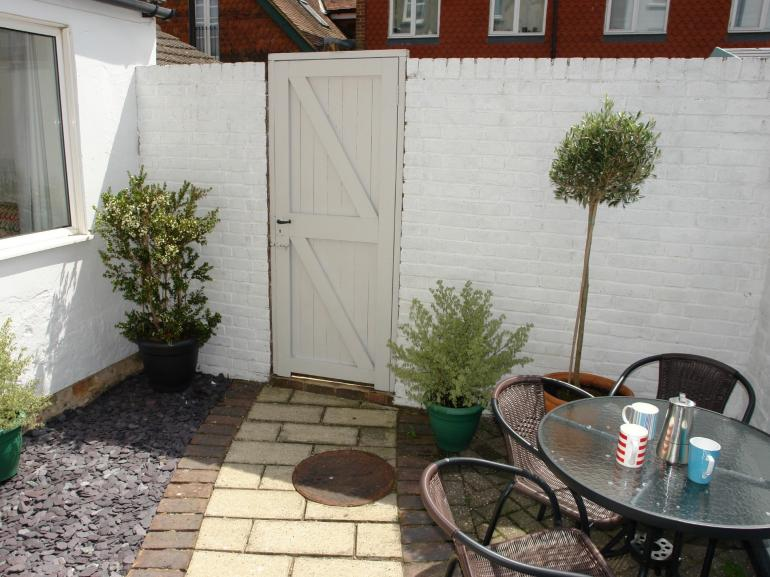 A secluded courtyard garden at this ground-floor apartment