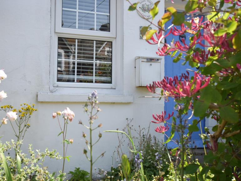 Pretty cottage garden to this front of this seaside property
